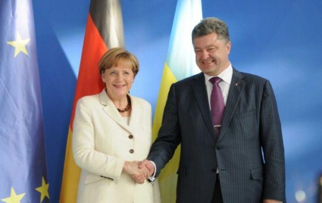 Меркель рассказала Петру Порошенко о деталях переговоров с Путиным